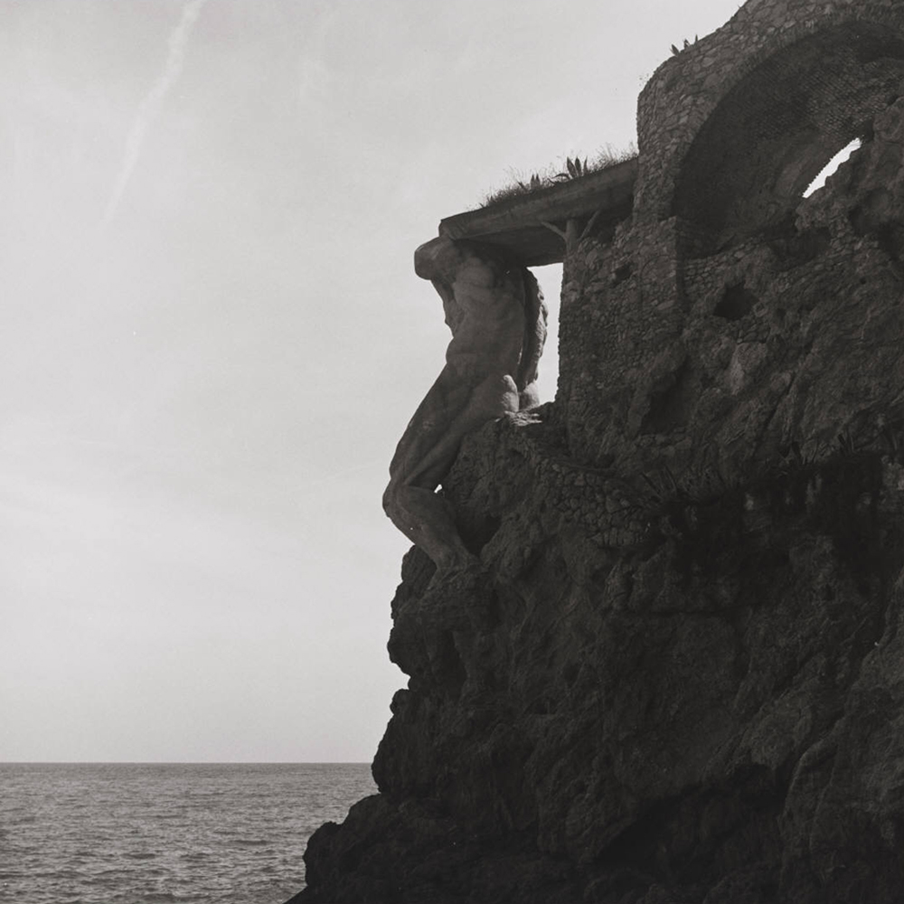 Italian coastline sculpture on cliff