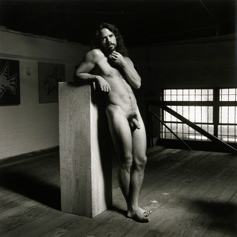 Untitled Male Nude Leaning Against Wooden Pedestal, 1989