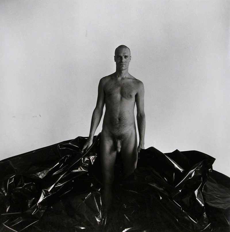 Untitled Male Nude Posed with Black Plastic